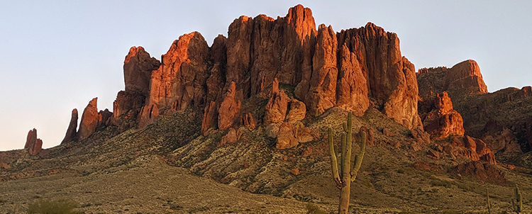 Image of desert, rocky mountains with Saguaro cactus in foreground