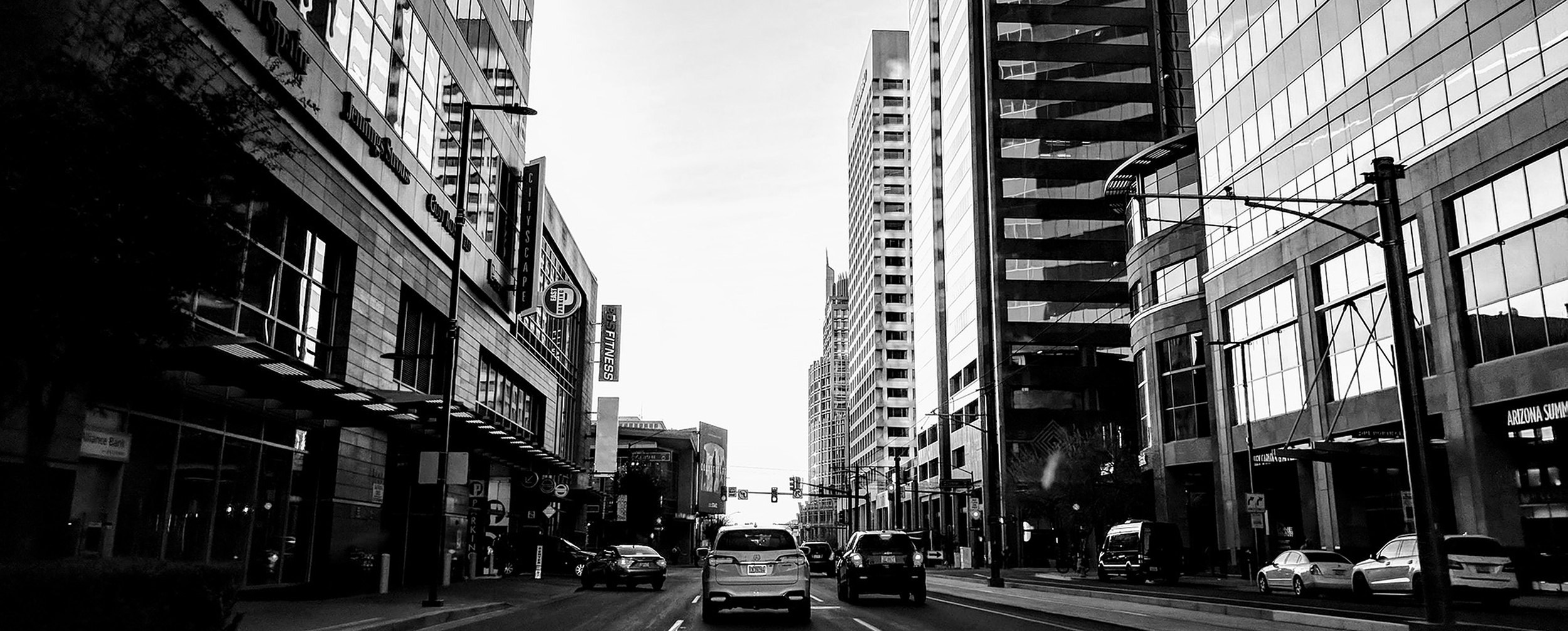 Photo of downtown Phoenix in black and white showing street and buildings