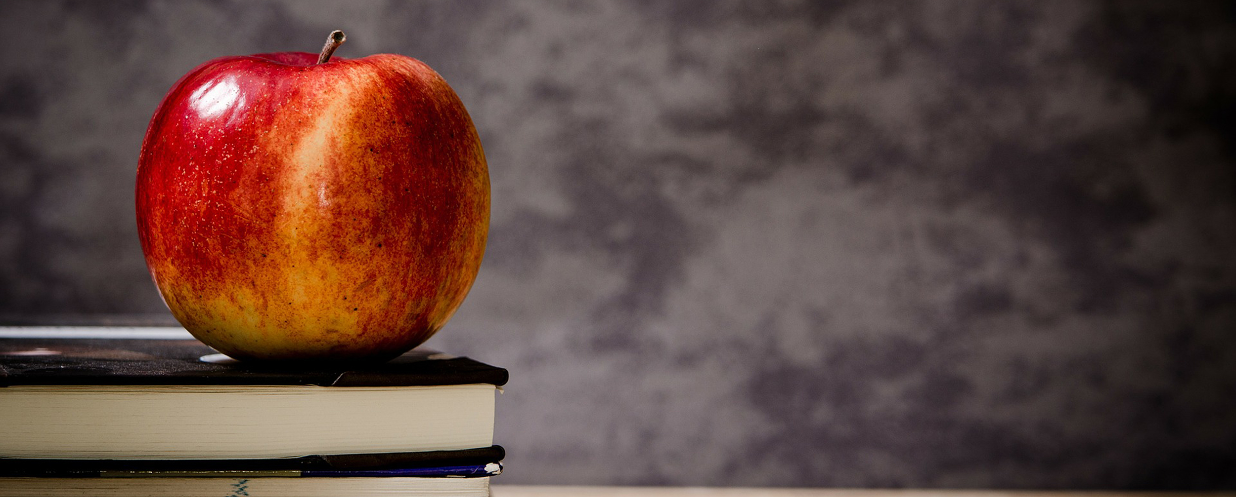 Image of an apple on a textbook