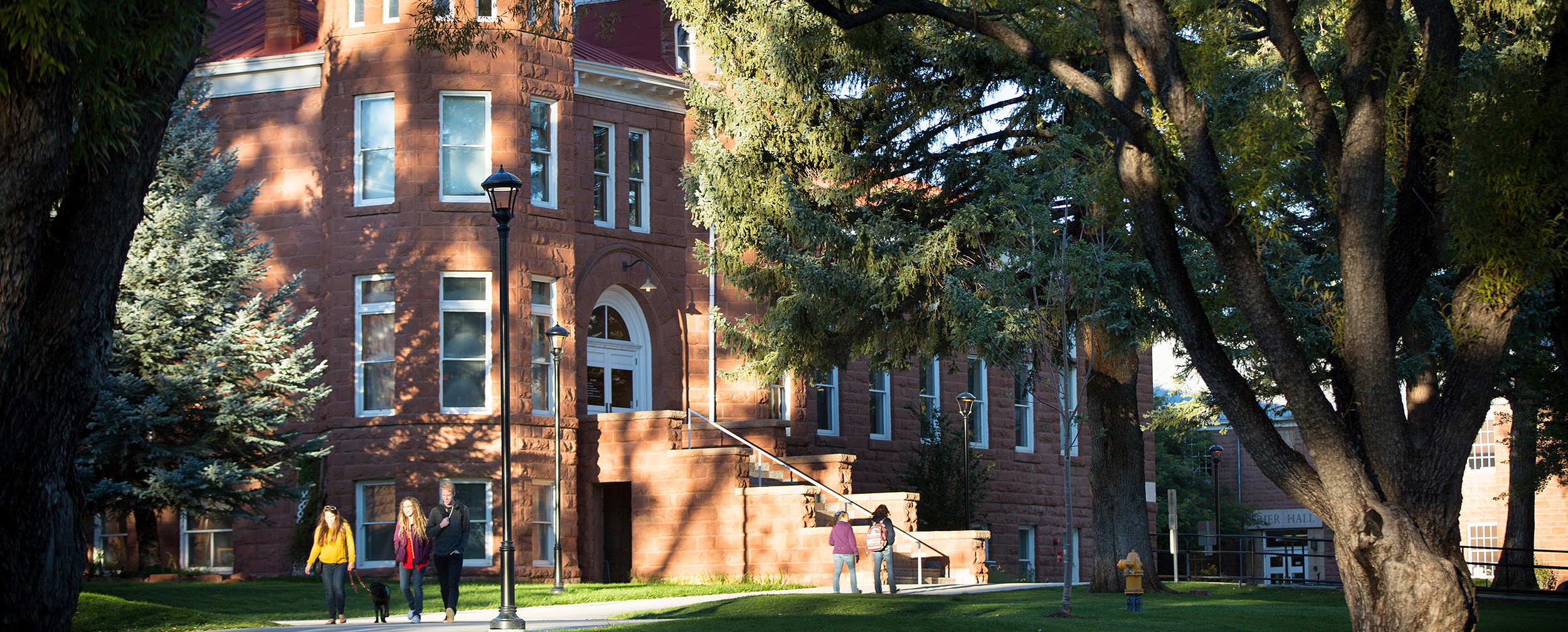 Photo of students walking outside of Old Main on NAU campus.