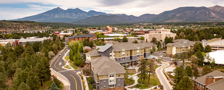 Aerial photo of the NAU campus with mountains in the background
