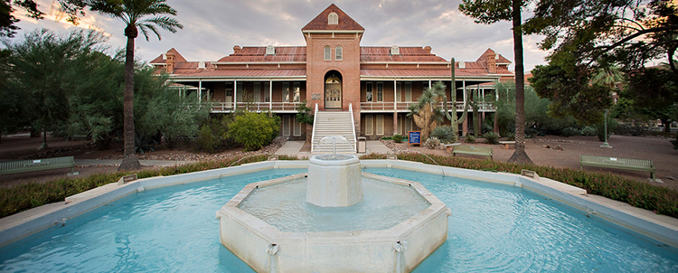 Image of Old Main on UArizona campus with fountain in foreground