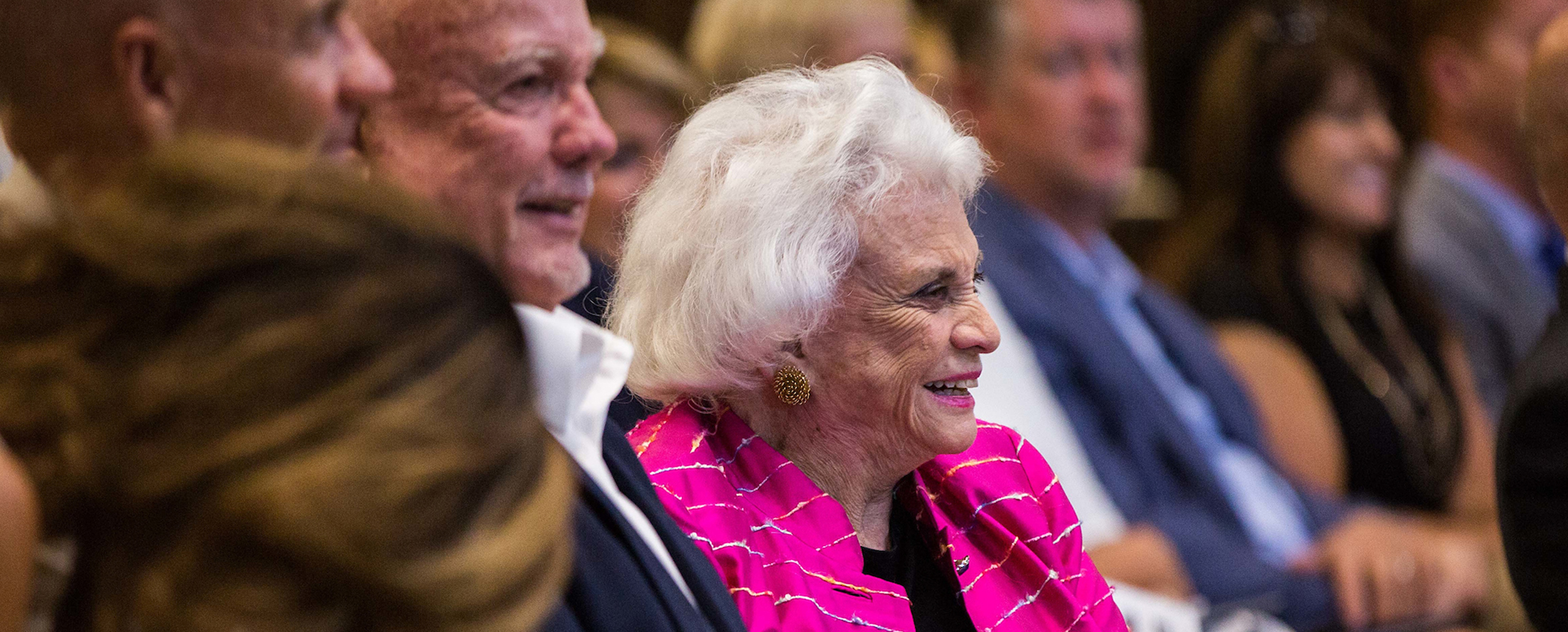Photo of former Supreme Court Justice Sandra Day O'Connor smiling at an event