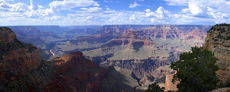 Overview photo of the Grand Canyon with clouds in the sky