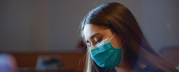 Photo of female student in face mask.